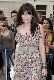 Daisy Lowe teamed an oversized gray belt with a cute floral dress for the Topshop Knightsbridge store opening.