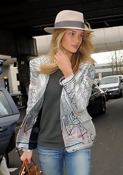 Rosie Huntington-Whiteley caught a flight to Cannes wearing a beige walker hat by Maison Michel.