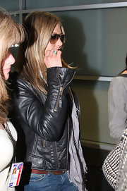Jennifer Aniston showed off a chic opal ring while arriving on a flight at JFK.
