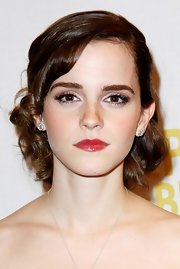 Emma Watson complemented her sweet updo with a pair of Boucheron Ava diamond studs.