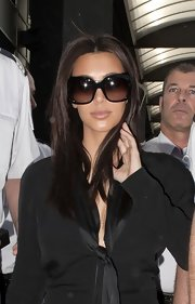 Kim Kardashian rocked a pair of oversized sunnies as she boarded a yacht in Cannes.