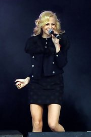 Pixie Lott performed at the Poppy Appeal show wearing a fur-trimmed pea coat.