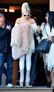 For a touch of luxe, Lady Gaga accessorized with a pale-pink fur shawl.