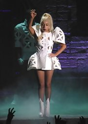 Lady Gaga performed at a concert wearing a sculptural white cutout dress.