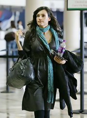 Famke Janssen wrapped her neck with a cozy-looking knit scarf.