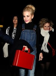Pixie Lott looked cool sporting this red leather briefcase and denim overalls combo during Rihanna's show.