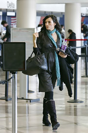 Famke Janssen donned winter gear at LAX featuring a pair of knee-high boots.