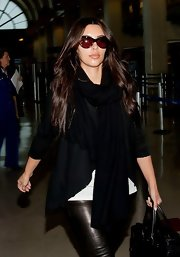 Kim Kardashian hid her eyes behind a pair of Dita cateye sunnies as she made her way through LAX.
