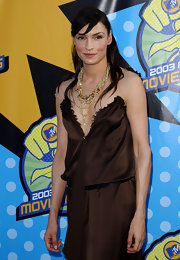 Famke Janssen covered her plunging neckline with a multi-layered necklace at the MTV Movie Awards.