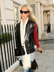 Poppy Delevingne concealed her eyes behind a pair of cateye sunnies while out and about in London.