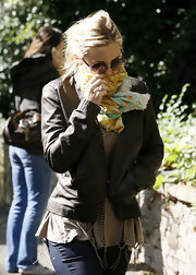 Kate Hudson tried to keep a low profile by covering her face with a scarf while strolling in London.