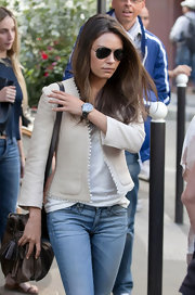 Mila Kunis accessorized with a diamond-set watch by Chanel for a day of shopping in Paris.