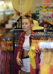 Miley Cyrus wore Citizens of Humanity cutoffs teamed with a crop-top while out shopping.