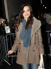 Keira Knightley kept warm with a blue knit scarf teamed with a leather coat while leaving the Vaudeville Theatre.