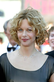 Meg Ryan attended the 2003 Cannes Film Festival opening ceremony wearing this cute curly bob.