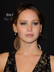 Jennifer Lawrence opted for an edgy-casual ponytail when she attended the BAFTA LA Tea.
