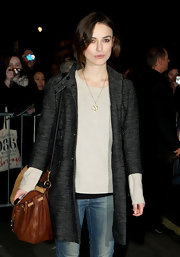Keira Knightley bundled up in a stylish Mayle tweed coat as she left the Comedy Theater.