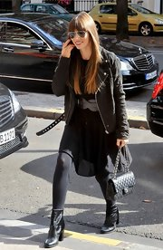 Jessica Biel arrived at her hotel rocking black AllSaints ankle boots with a moto jacket.