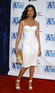 Padma Lakshmi chose a gold sequin clutch to pair with her dress.