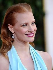 Jessica Chastain paired her brushed-back hairstyle with gorgeous emerald-cut diamond drop earrings by Harry Winston during the Golden Globes.