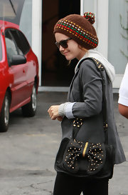 Rachel Bilson bundled up in cute style with a colorful pompom beanie while visiting the Miauhaus Studios.