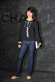 Actress Karina Lombard paired this black and white blouse with classic blue jeans for a casual but chic look.