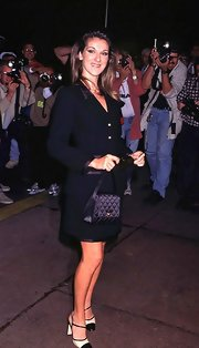 Celine Dion tied her look together with a quilted satin purse.