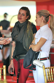 Charlotte Casiraghi kept cozy with a gray pashmina at the Global Championship Show Jumping Final.