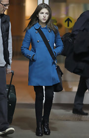 Anna Kendrick traveled in cute style wearing this silver-buttoned blue pea coat.
