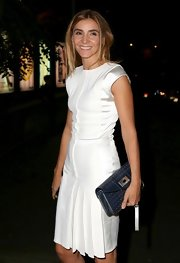 Clotilde Courau paired her frock with a navy envelope clutch.
