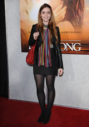 Lily Collins livened up her outfit with a rainbow-hued scarf.
