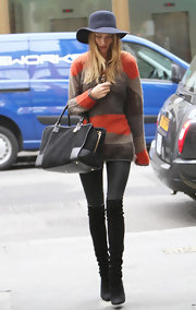 Rosie Huntington-Whiteley was spotted out in London rocking a pair of black knee-high boots.