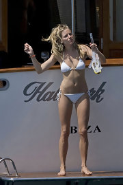 Sienna Miller frolicked on a boat wearing a white halter bikini.