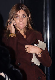 Carine Roitfeld finished off her look in ultra-glam style with an etched gold cuff bracelet.