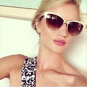 Rosie Huntington-Whiteley took a selfie wearing a pair of chic white-framed cateye sunglasses by Oliver Peoples.