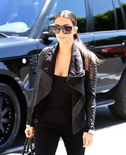 Kim Kardashian accessorized with ultra-modern rectangular shades by Celine.
