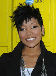Monica went super edgy with this spiked hairstyle at the Get Schooled conference.