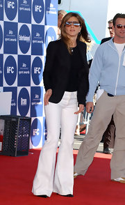 Jennifer Aniston paired her jacket with super-flared white pants.