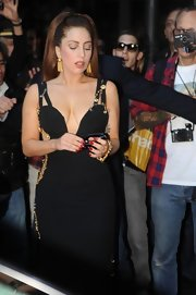 Lady Gaga sported red mani for a pop of color to her black dress while out in Milan.