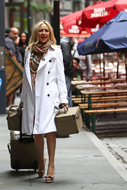 Kate Hudson filmed scenes for 'Something Borrowed' looking stylish in a white trenchcoat.