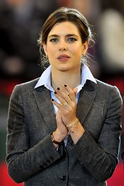 Charlotte Casiraghi styled her suit with a variety of gold bracelets for the Gucci Masters competition.
