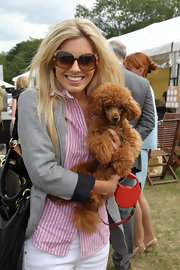 Mollie King accessorized with '70s-chic oversized sunnies while watching a polo match.