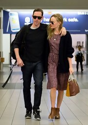 An oversized black cardigan added some warmth to Kate Bosworth's lightweight dress as she made her way through LAX.