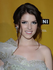 Anna Kendrick complemented her lovely hairstyle with a luxurious pair of dangling diamond earrings.
