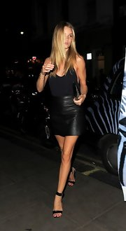 A black leather mini skirt rounded out Rosie Huntington-Whiteley's sultry look.