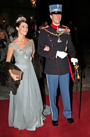 Princess Marie donned a gray ballgown with an asymmetrical neckline for the New Year's party at Amalienborg Palace.
