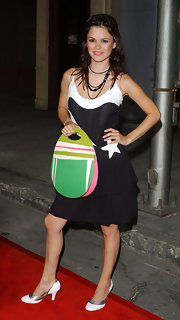 Rachel Bilson completed her outfit with a colorful egg-shaped tote.