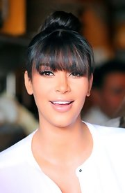 Kim Kardashian went shopping in Beverly Hills wearing her hair piled on top of her head in a playful bun.