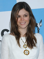 Rachel Bilson styled her plain white dress with a colorful gemstone statement necklace.
