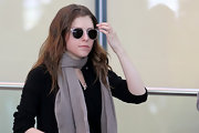 Anna Kendrick looked a little mysterious at the airport hiding her eyes behind a pair of clear-rimmed wayfarers.